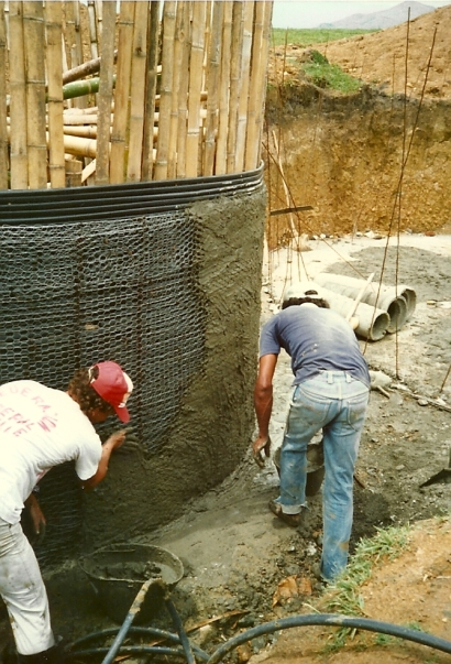 Plastering The Outside Of The Water Storage Tank